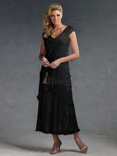 Mother of the Bride Dresses - Capri by Mon Cheri dress 11016-3. Silk burnout dress with cowl neckline and cap sleeves, bias-cut tea-length skirt with chevron overlay. Matching shawl included. Shown in Black