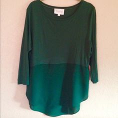 Two by Vince Camuto green top. Beautiful! In like new condition. All 100% rayon, but top is a soft knit. The contrast and shirt tail hem make the top darling. The color is a gorgeous emerald green. The contrast in color in the top and bottom is much less noticeable in real life than photo. Vince Camuto Tops