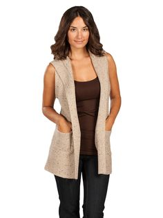 I would out this vest over a long sleeve tee or very light cashmere sweater :)