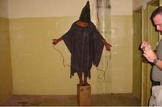 One of the shocking images released which showed US military torturing and abusing Iraqi prisons in Abu Ghraid prison.  Two soldiers, Specialists Charles Graner and Lynndie England, were imprisoned for their crimes against the prisoners, while many more were dishonorably discharged.