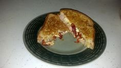 Grilled Greek - Feta cheese with sun-dried tomatoes, and a slice of provolone to bind the sandwich together.