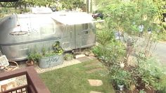 I would love to have an Airstream trailer guest house like this.