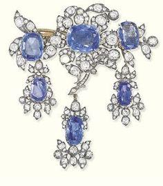 AN ANTIQUE SAPPHIRE AND DIAMOND BROOCH, CIRCA Of girandole design, the oval-shaped sapphire and old-cut diamond flowerhead centre with sapphire and diamond foliate sprays to either side suspending three pendants of similar design, cm wide. Royal Jewelry, Jewelry Sets, Fine Jewelry, Head Jewelry, Victorian Jewelry, Antique Jewelry, Vintage Jewelry, Diamond Tiara, Diamond Cuts