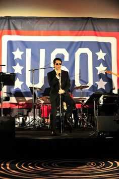 """John Lloyd Young sings """"Unchained Melody"""" at the USO Annual Awards Gala for the Joint Chiefs of Staff, members of Congress, wounded warriors and members and friends of the United States Armed Forces. Washington, D.C., March 14, 2013. photo: Evin Planto"""