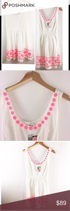 Vineyard Vines summer dress NWT Vineyard Vines embroidered dress  White fit and flare dress Bright pink embroidered trim detail  Side zipper closure Beautiful, simple dress. Great for beach getaways.  New with tags Size 12 100% cotton Vineyard Vines Dresses