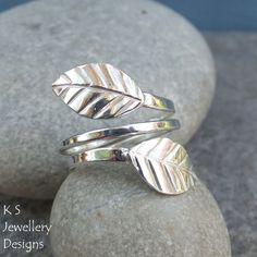 Handmade Metalwork Sterling and Fine Silver Wraparound Leaves Ring READY TO SHIP - This MEDIUM sized adjustable ring can fit many sizes - please ask if you are unsure whether this will fit you) This eye-catching wraparound ring has been completely han. Jewellery Designs, Handmade Jewellery, Jewellery Making, Jewellery Earrings, Gemstone Jewelry, Sterling Silver Jewelry, Silver Rings, Leaf Ring, Wrap Around