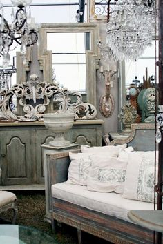 Love chandelier mixed with weathered furniture.