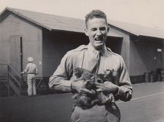 American soldier Holding Kittens Getting Scratched Up, 1940's
