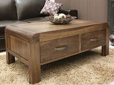 Our solid walnut coffee table features four drawers which are great at swallowing all that living room clutter whether its T.V remotes or magazines and newspapers.  Each drawer is finished with lovely dovetail joints and has stylish antiqued bronze handles.