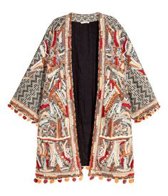 Jacket in jacquard-weave cotton fabric with beaded embroidery and an embroidered pattern at front. 3/4-length sleeves with pompom fringe at cuffs and hem, and no buttons. Lined.