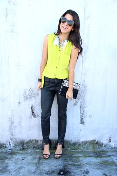 Yellow sleeveless blouse, black leather pants, strappy heels
