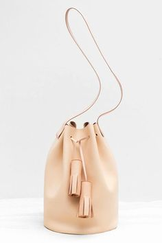 14 Bucket Bags To Buy When Mansur Gavriel Isn't An Option #refinery29  http://www.r29.com/best-bucket-bags#slide-8  A neutral hue that pairs with everything.Building Block Bucket in Nude, $485, available at Building Block....