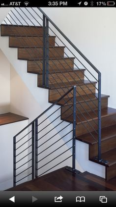 metal stair railing with dark wood
