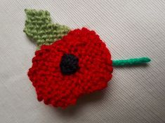 Poppy knitting pattern to make your own handmade knitted poppy. Wear one to show your support for the British Legion Poppy Appeal! Knitted Poppy Free Pattern, Leaf Knitting Pattern, Knitted Flower Pattern, Knitted Poppies, Teddy Bear Knitting Pattern, Baby Cardigan Knitting Pattern Free, Knitted Doll Patterns, Knitted Flowers, Baby Knitting Patterns
