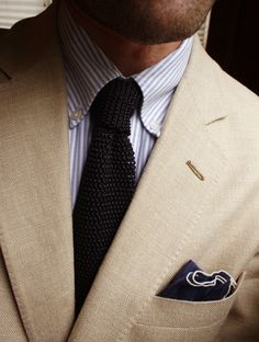 A great summer combination: wheat color linen suit, light blue and white striped shirt, and a midnight blue knit tie.