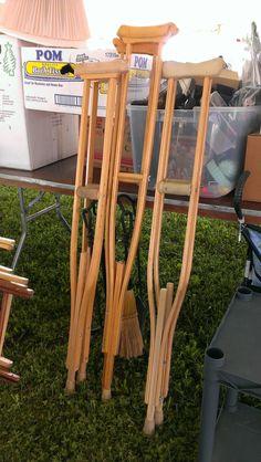 Invert crutches to make a bookshelf