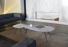 Estremoz marble coffee table with slim, brushed steel legs