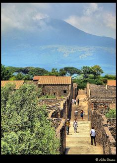 *POMPEII, ITALY:    an important, Roman Town, was partially destroyed + buried under 4-6 m (13-20 ft) of ash + pumice in the eruption of Mount Vesuvius in AD 79, + it was lost for nearly 1700 yrs before it accidental rediscover in 1749.