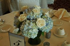 Blue hydrangeas with white roses.