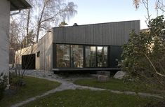 Gallery of Atelier-House -Huttunen-Lipasti-Pakkanen Architects _ Finland; local material; wood & glass & black frame; elevated from the ground; cool gutter with chains