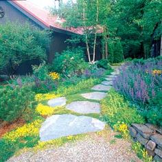 Photo: Jerry Pavia	  Broad stepping stones laced with low-growing plants create an informal path that complements this rustic Vermont home and its free-form garden beds.