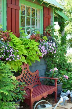 Window Boxes in bloom on the Potting Shed | ©homeiswheretheboatis.net #sheshed #garden #summer #flowers