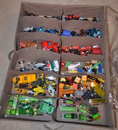 organize little boys' cars and trains by color with an under-the-bed shoe organizer- this would be great for all little toys and to get rid of the toy baskets in the kids rooms!!