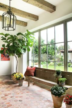 Have indoor plants in your house? If now you want to have the green elements in your house, here we offer some of nicest indoor plant designs that might help you to make you living space fresher, breathable, and chic. Terracotta Floor, Growing Plants Indoors, Interior And Exterior, Interior Design, Interior Ideas, Interior Plants, Modern Exterior, Spanish Style, Spanish Colonial