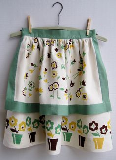 I like this style for a half apron with a dishtowel as one of the layers. Still cute though!