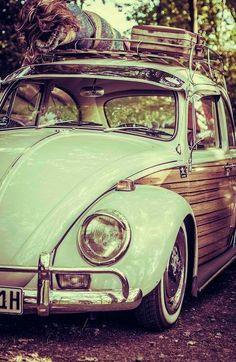 Vintage Bug with luggage rack and wood paneling:
