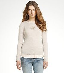 Tory Burch sweater with logo.