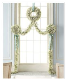 Prim and Proper Baby's Breath Arch.