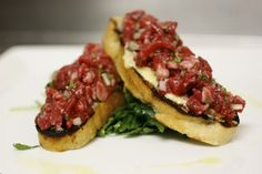 beef filet tartare on grilled ciabatta with wild arugula, lemon, pancetta aioli