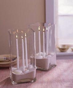 Centros de mesa con arena y velas