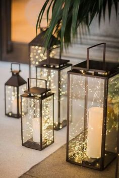 Rustic and elegant lanterns with candles - perfect for wedding table decor and centerpiece! Love this traditional and elegant wedding decor! Perfect for a romantic, traditional and elegant wedding, DIY wedding inspirations. Rustic Lanterns, Lanterns Decor, Rustic Candles, Ideas Lanterns, Pillar Candles, Outdoor Candles, Wedding Ideas With Lanterns, Lanterns For Weddings, Hanging Lanterns Wedding