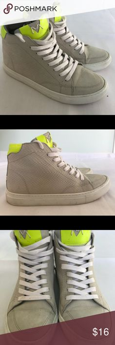 Modern Vintage leather Hi-top Sneakers Previously loved leather hi-top sneakers by Modern Vintage. Light dove grey Nubuck leather upper with neon yellow leather accents. Inside zip and lace up closure, leather lining, synthetic sole. There are a few tiny mud spots on the front of the shoes the size of pinpricks. Modern Vintage Shoes Sneakers
