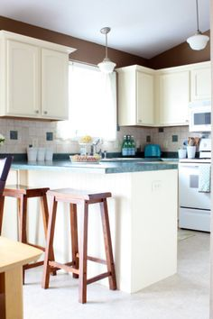 Behr Belgian Sweet and Behr Navajo White kitchen paint colors