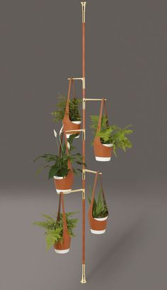 Plants hang on leather slings from the leather-covered arms of Totem Floral by Damien Langlois-Meurinne