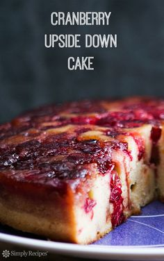 Dense and delicious cake with caramelized cranberries. Perfect dessert for Thanksgiving and holiday entertaining! On SimplyRecipes.com