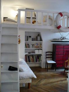 Recessed shelving in nautical themed tiny house