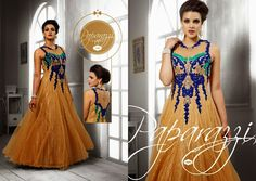 Superbly Designed Party wear indo-western Netted Gown in Mustard color. En-crafted with beautiful work. Matching Santoon Bottom and Inner included.
