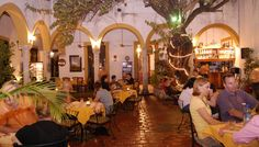 Amaro - Merida, Yucatan: This romantic dining spot (especially at night, when there's performing trova acts) is in the courtyard of the house where Andrés Quintana Roo – poet, statesman and drafter of Mexico's Declaration of Independence – was born in 1787. The menu includes yucateco dishes and a variety of vegetarian plates, as well as some continental dishes.    Read more: http://www.lonelyplanet.com/mexico/yucatan-peninsula/merida/restaurants/international/amaro#ixzz34TD9sGMs