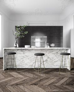 Marble kitchen island + dark wood cabinetry. Talcik Demovicova