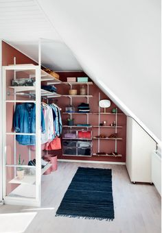 Colorfull wardrobe with a lot of smart and open storage. See more details of the storage and organizing solutions here.