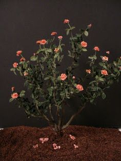 miniature rose bush tutorial - flowers are paper so not waterproof, but you could sub tiny fabric roses for outdoor use ******************************************** TheLittleHouseatPineHaven - #miniature #rose #bush #fairy #garden #dollhouse - t√