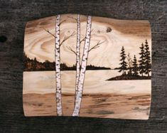 This original wood burned art features a misty lakeside morning. A knot in the wood in one corner creates the sun and a light wash casts a warm glow to the sky. Signed and dated on the back. Measures 9 1/4 inches square by 3/4 inches deep on solid wood. Carefully wrapped and ready to ship.