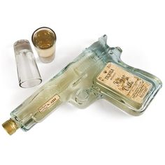 Tequila Shooters - Glass Pistol Shaped Bottle Filled with Gold Tequila. Comes with Shot Glasses and Display Stand