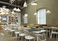 Cornerstone Cafe by Paul Crofts Studio in a former munitions store in London's Royal Arsenal with chevron motifs referencing military uniforms.