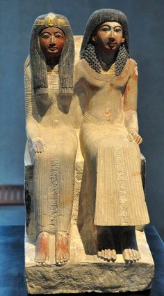 Limestone statue of the seated figure of priest Neje and Mutnefret,his mother.New Kingdom,19th Dynasty,13th and 12 centuries B.C.