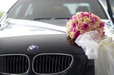 Wedding car decorations/// not a fan of the flowers, but love the rest